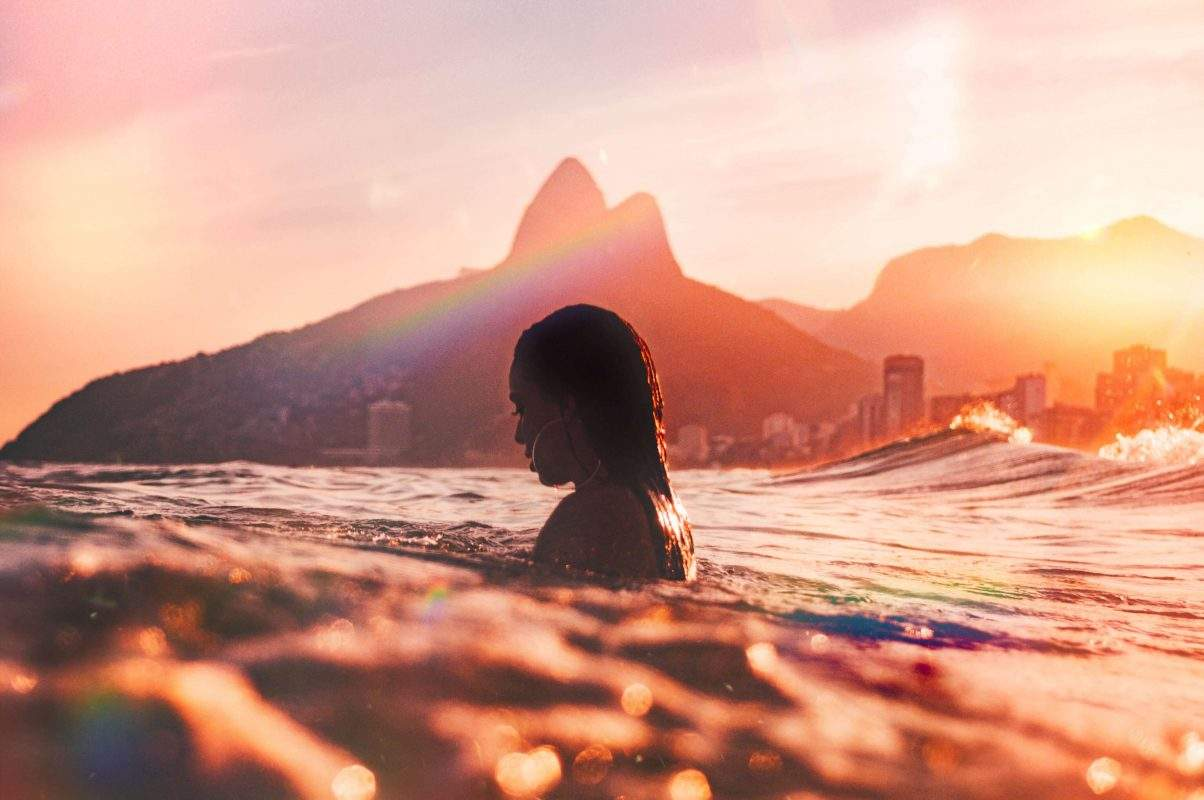 woman in water during sunset
